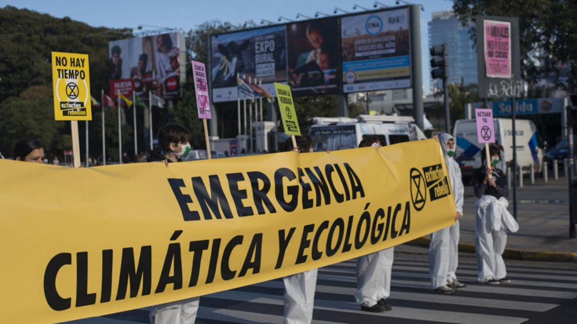Members of Extinction Rebellion demonstrate at the La Rural exhibition centre in Buenos Aires.