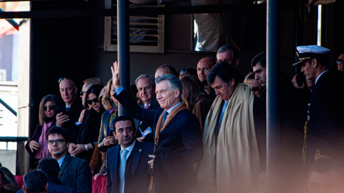 President Mauricio Macri waves while leaving an event at La Exposicion Rural agricultural and livestock show in Palermo on Saturday, August 3, 2019.