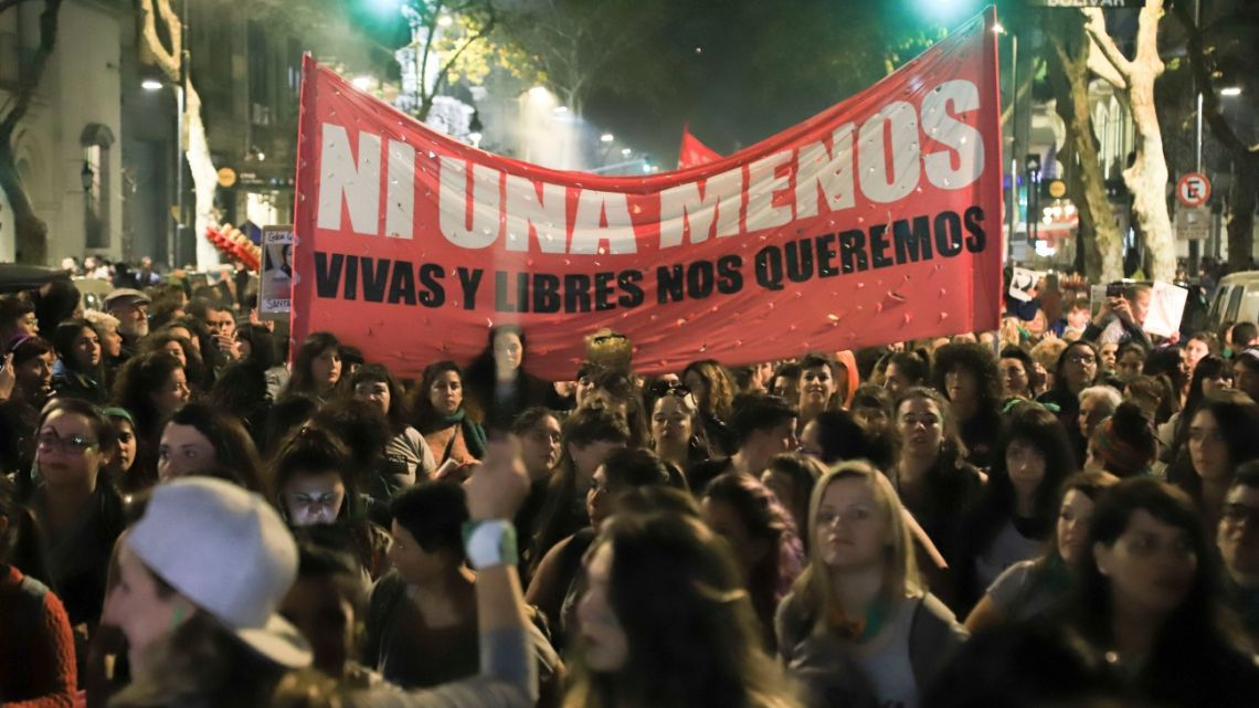 Thousands of women march from Congress to Plaza de Mayo to demand an end to femicide and violence against women.