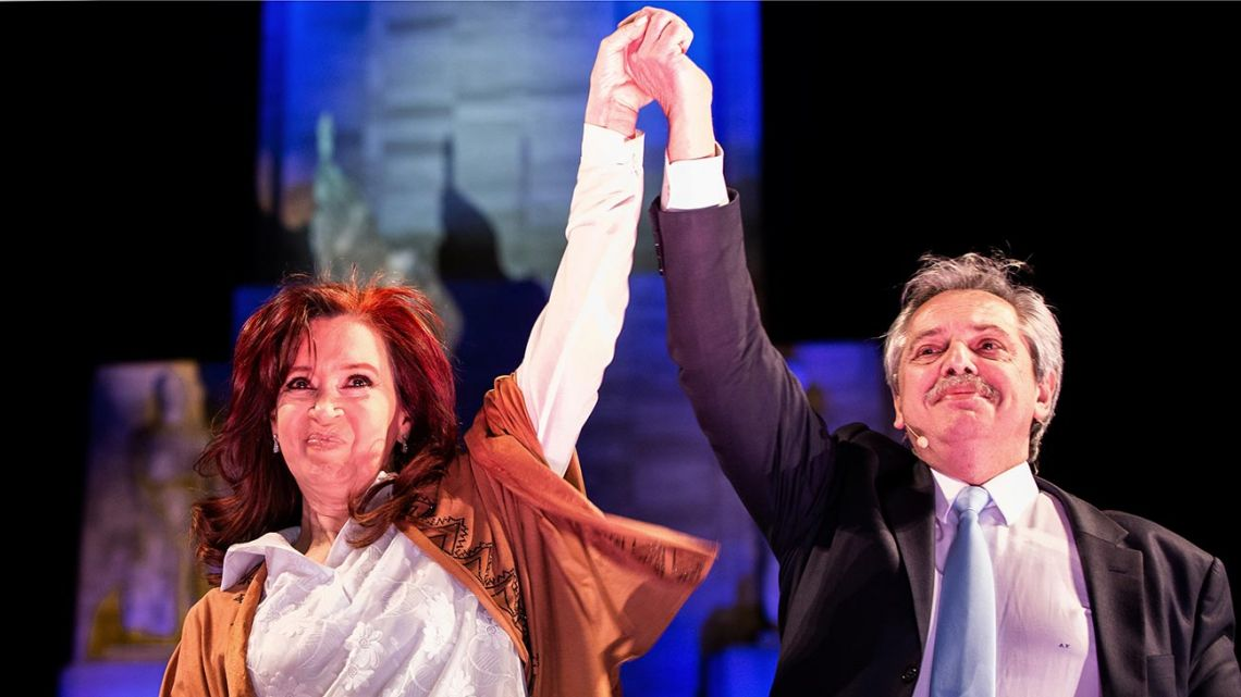 In this handout photo released by Frente de Todos, presidential hopeful Alberto Fernández (right) and former President, current senator and vice-presidential hopeful Cristina Fernández de Kirchner wave to supporters during their closing camapign rally in Rosario, Santa Fe, on August 7, 2019.