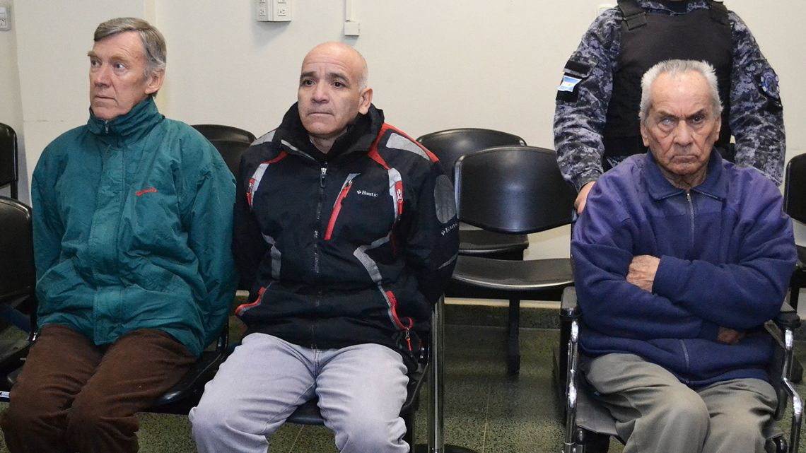 In this handout picture released by Mendoza Judiciary, Horacio Corbacho, in green jacket, Armando Gomez, center, and Nicola Corradi, in wheelchair, sit in a courtroom prior to their trial in Mendoza.