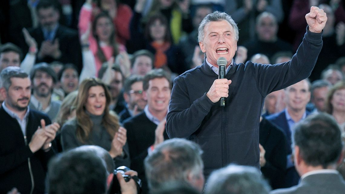 President Mauricio Macri, flanked by his closest allies and supporters, pitches to voters on Thursday night.