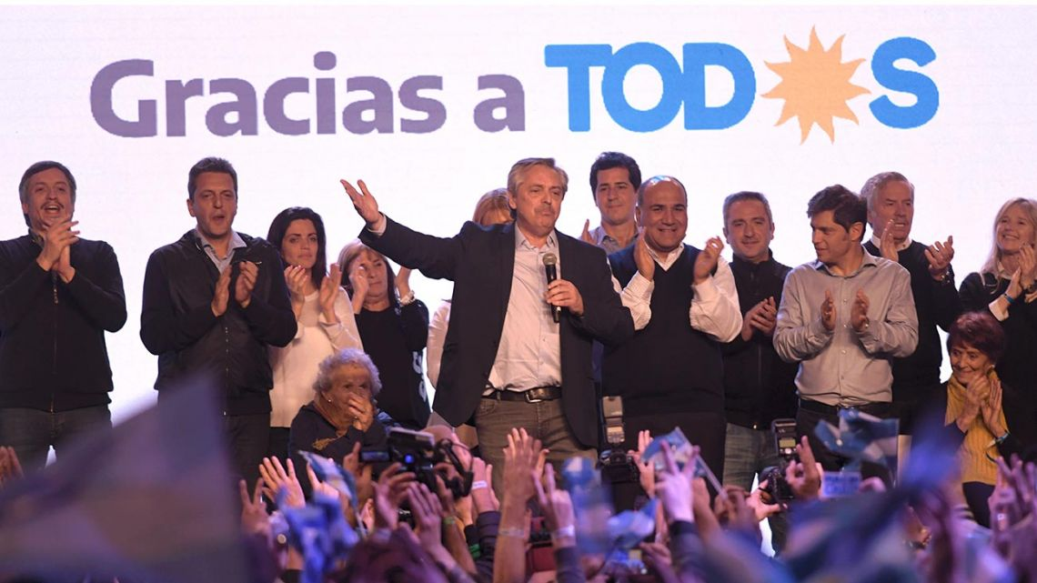 Alberto Fernández, flanked by key members of the Frente de Todos coalition, addresses supporters from his party's bunker in Chacarita on the night of the PASO primaries.