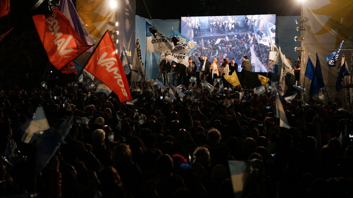 "Presidential candidate Alberto Fernández waves to supporters at the Frente de Todos party bunker in Chacarita on Sunday night. 2019. The ""Frente de Todos"" presidential ticket with former President Cristina Fernández emerged as the strongest vote-getter in Argentina's primary elections Sunday, indicating conservative President Mauricio Macri will face an uphill battle going into general elections in October."