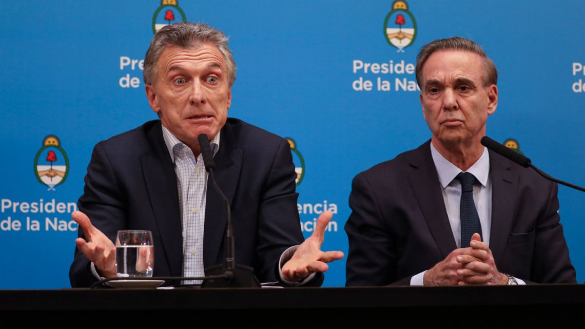 President Mauricio Macri, who is running for re-election, gives a press conference alongside running-mate Miguel Ángel Pichetto, the day after primary elections at the Casa Rosada.