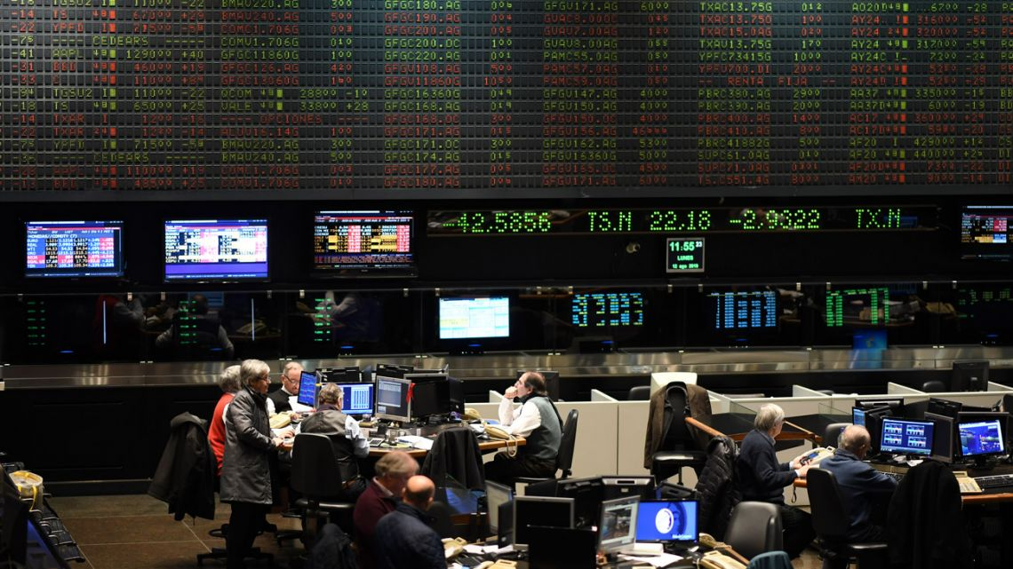 Traders are seen at the Stock Exchange in Buenos Aires.