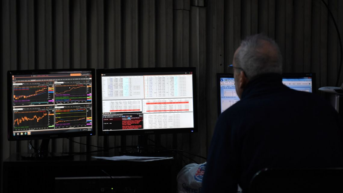 A trader works at the Stock Exchange in Buenos Aires.
