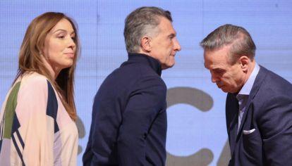 CONTRASTE. La seriedad oficialista y la euforia opositora. Fernández, pero también Axel y Máximo.