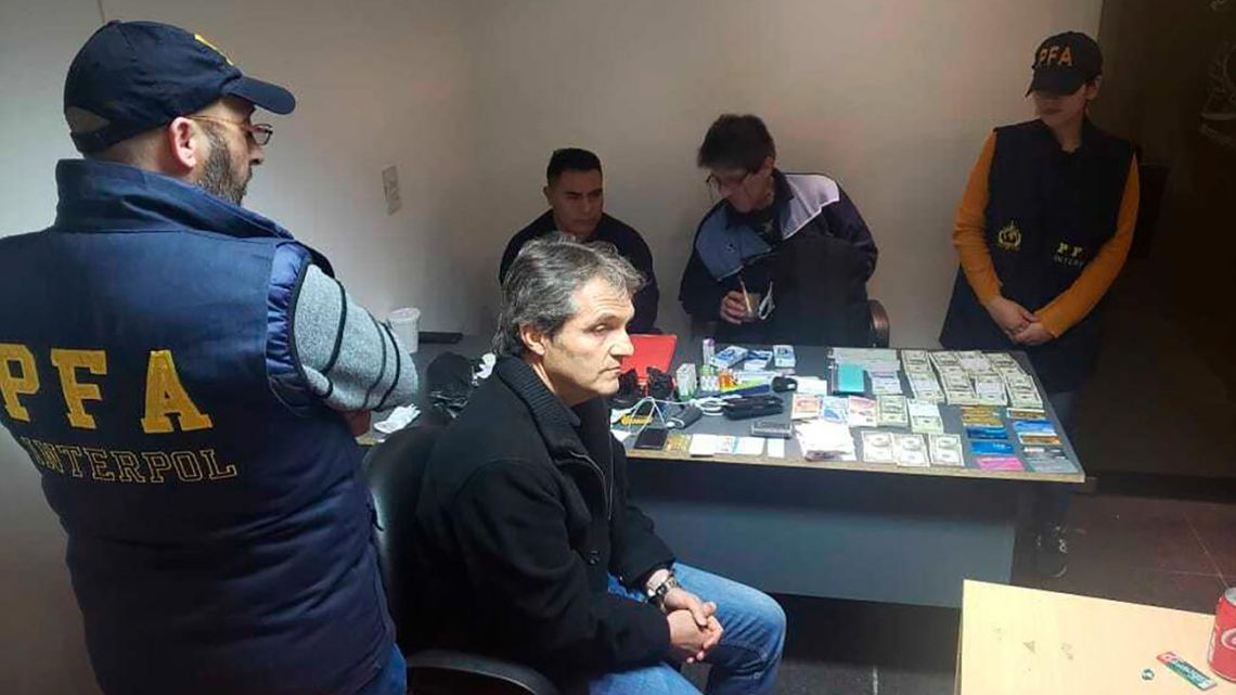 In this handout photo provided by the Argentine Federal Police, Carlos Ahumada, a Mexican-Argentine businessman, is detained at the Jorge Newbery International Airport in Buenos Aires on Friday.