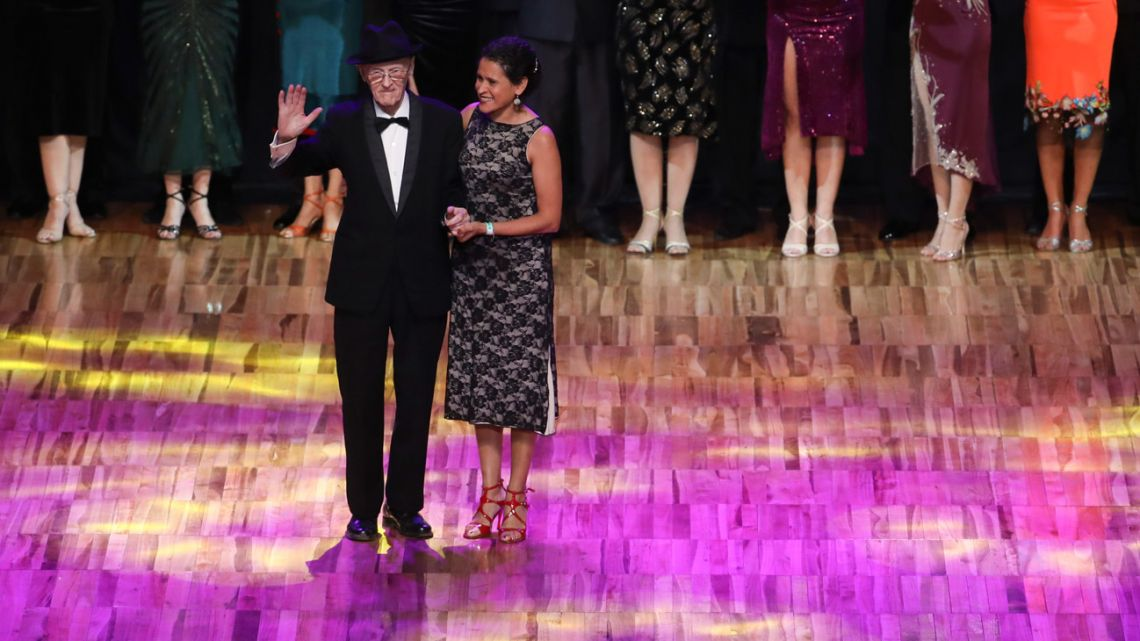 99-year-old James McManus and his dance partner Lucía Seva, stand on stage to be recognised during the finals of the Salon category at the annual Tango Dance World Championship in Buenos Aires.
