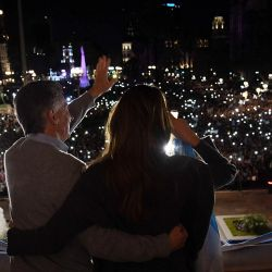 President Mauricio Macri and his wife, Juliana Awada, wave from the balcony of the Casa Rosada to supporters.