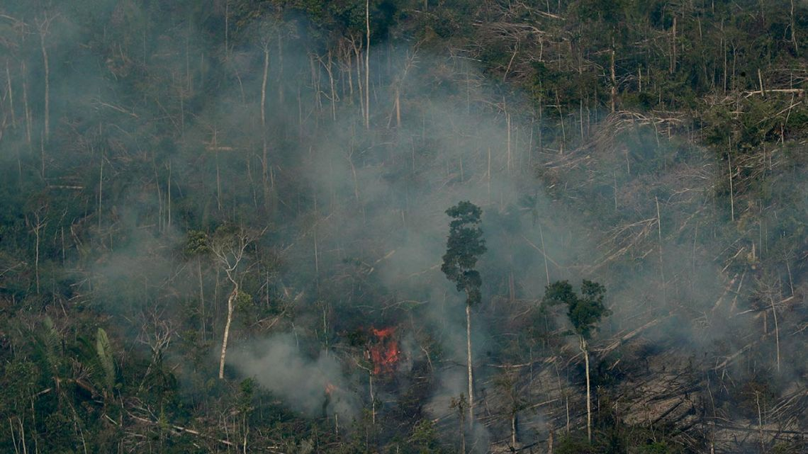 Fire consumes an area near Jaci Parana, state of Rondonia, Brazil, Saturday, Aug. 24, 2019. Brazil says military aircraft and 44,000 troops will be available to fight fires sweeping through parts of the Amazon region. The defence and environment ministers have outlined plans to battle the blazes that have prompted an international outcry as well as demonstrations in Brazil against President Jair Bolsonaro's handling of the environmental crisis.