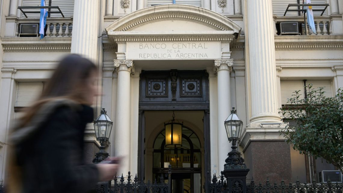 A woman passes by the headquarters of Argentina's Central Bank in the financial district of Buenos Aires on August 20, 2019.