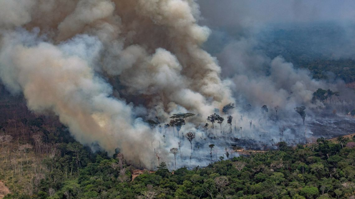 Handout aerial released by Greenpeace showing smoke billowing from forest fires in the municipality of Candeias do Jamari, close to Porto Velho in Rondonia State, in the Amazon basin in northwestern Brazil, on August 24, 2019. Brazil on August 25 deployed two Hercules C-130 aircraft to douse fires devouring parts of the Amazon rainforest. The latest official figures show 79,513 forest fires have been recorded in the country this year, the highest number of any year since 2013. More than half of those are in the massive Amazon basin. Experts say increased land clearing during the months-long dry season to make way for crops or grazing has aggravated the problem this year.
