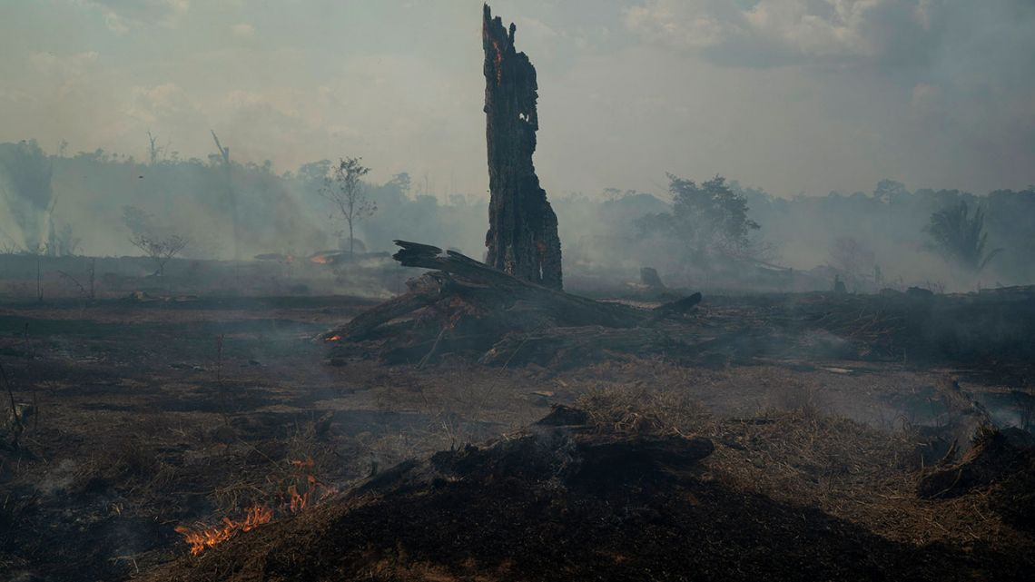 Land smolders during a forest fire in Altamira in Brazil's Amazon, Monday, Aug. 26, 2019. The fire is very close to Kayapo indigenous land located on the Bau indigenous reserve.