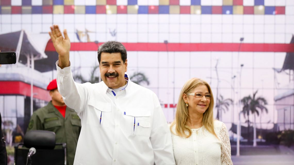 Venezuela's President Nicolás Maduro waving next to his wife Cilia Flores during the inauguration of a passenger terminal in La Guaira, Venezuela, on August 20, 2019.