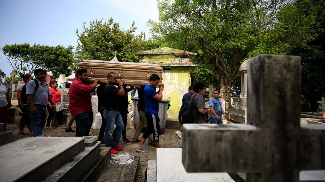 Mourners carry the coffin that contain the remains of Erick Hernandez Enriquez, also known as DJ Bengala, who was killed in an attack on the White Horse nightclub where he was DJ'ing, as they bring him for burial at the municipal cemetery in Coatzacoalcos, Veracruz state, Mexico, Thursday, Aug. 29, 2019.