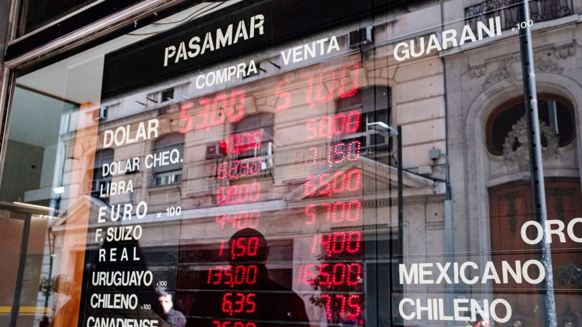 Electronic boards at an exchange house in Buenos Aires.