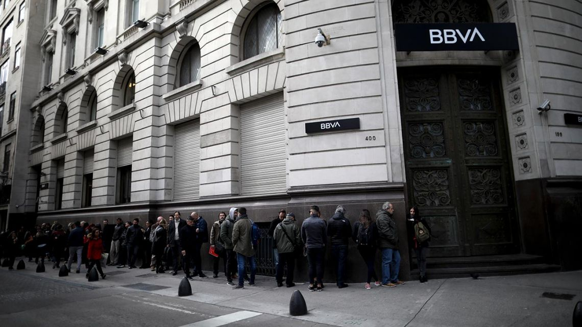 Argentines wait in line for a BBVA bank to open in Buenos Aires.