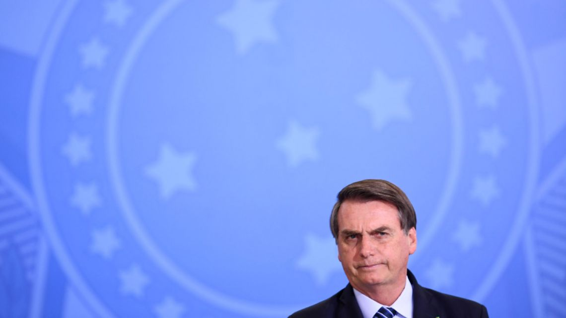 Brazilian President Jair Bolsonaro gestures during the launching ceremony of the Front Brazil Project, which aims at reducing the rates of violence in cities, at Planalto Palace in Brasilia, on August 29, 2019.