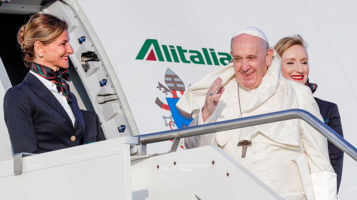 Pope Francis waves as he boards an aircraft on his way to Maputo, Mozambique, in Rome's Fiumicino International airport, Wednesday, Sept. 4, 2019. Pope Francis heads this week to the southern African nations of Mozambique, Madagascar and Mauritius, visiting some of the world's poorest countries in a region hard hit by some of his biggest concerns: conflict, corruption and climate change.