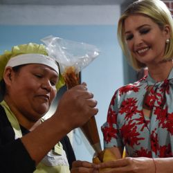 "Ivanka Trump, US President Donald Trump's daughter and White House adviser, visits Graciela Cristina Alcocer's bakery and Etelvina Acevedo's ""Today Pachama"" clothing shop, as she visits Jujuy Province."