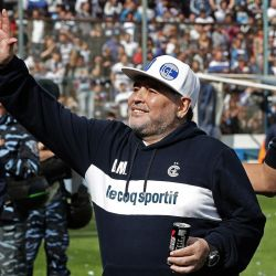 Diego Maradona waves next to Gimasia Club President Gabriel Pellegrino (right), during the first training session of the team with him as coach at the El Bosque stadium, in La Plata, Buenos Aires Province.