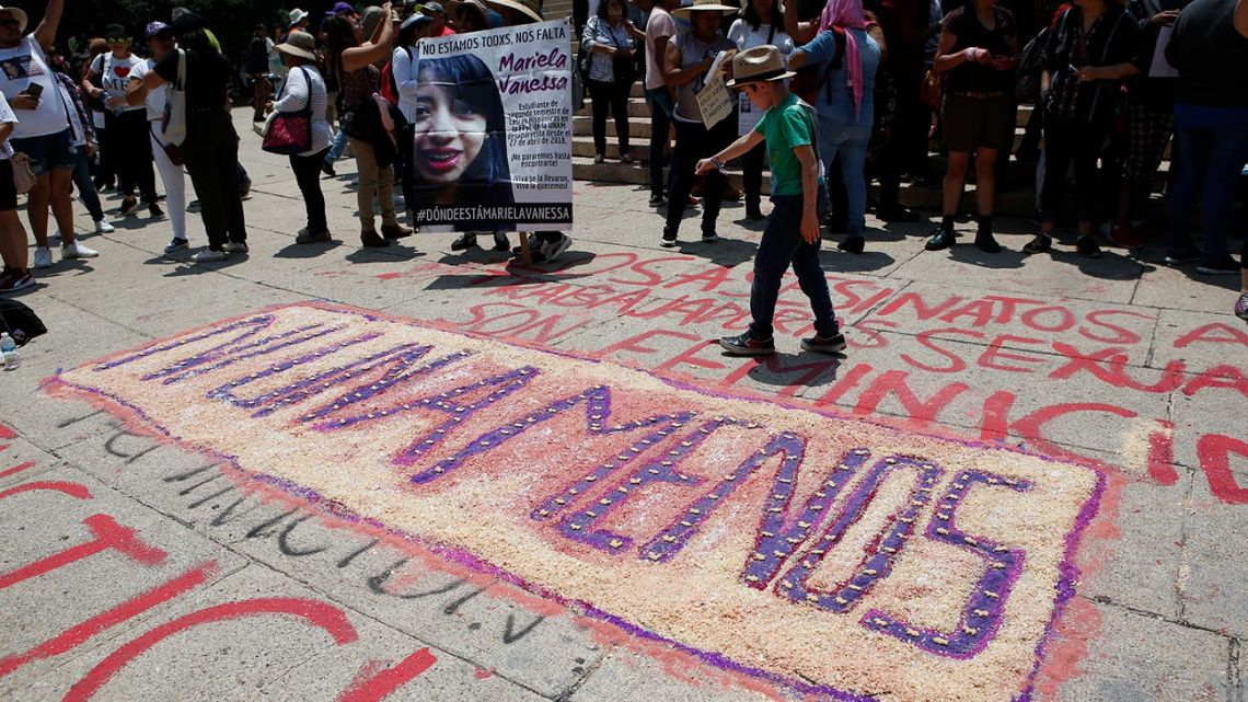 """A drawing reads in Spanish: """"Not one less,"""" at the start of a silent march to remember murdered women and demand justice for them in Mexico City, Sunday, September 8, 2019."""
