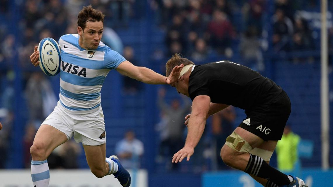 In this file photo taken on July 20, 2019 Argentina's Los Pumas fly-half Nicolás Sánchez (L) runs past a tackle by New Zealand's All Blacks flanker Sam Cane, during a Rugby Championship match at José Amalfitani stadium in Buenos Aires.
