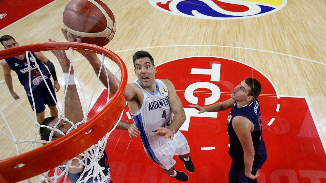 Argentina's Luis Scola (centre) takes a shot during the Basketball World Cup quarter-final game between Argentina and Serbia in Dongguan on September 10, 2019.