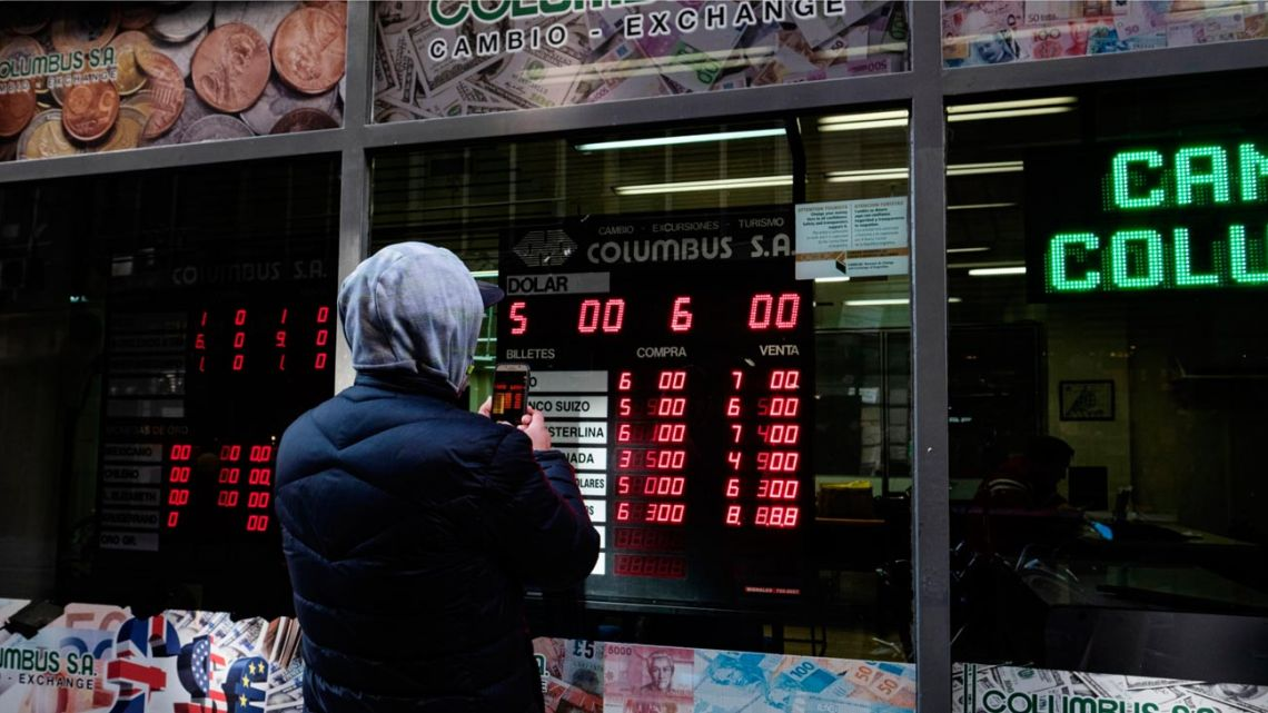 A man stands outside a currency exchange in Buenos Aires.