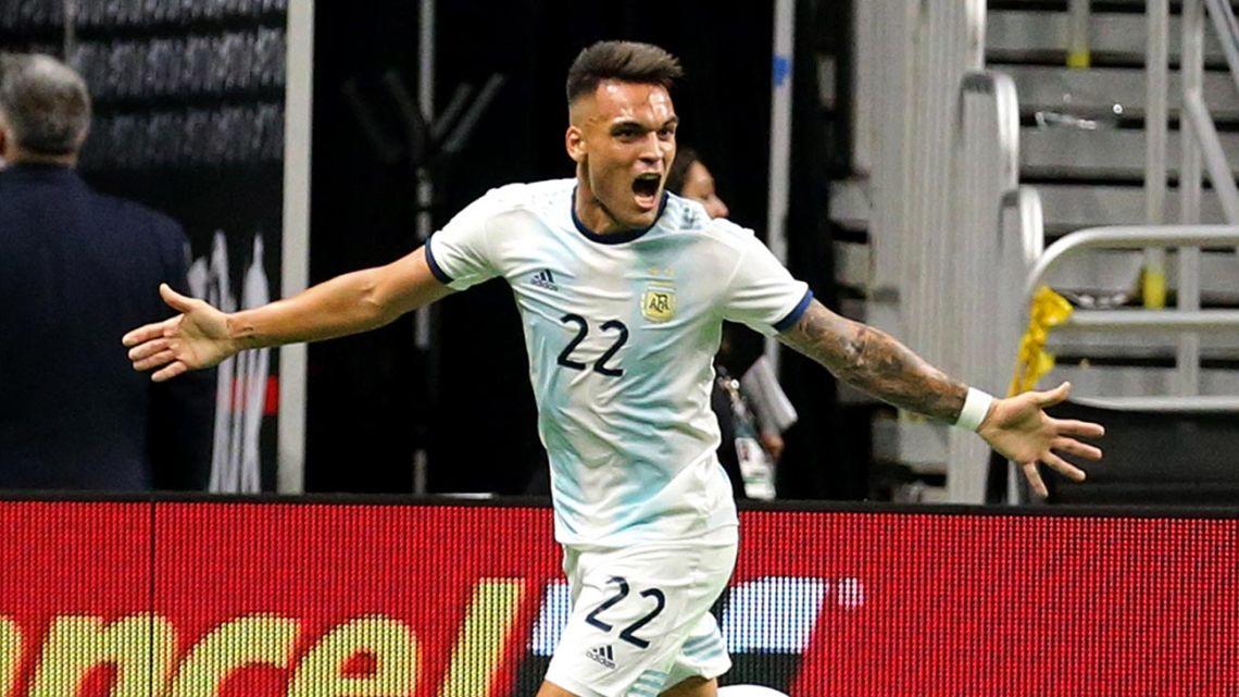 Lautaro Martínez celebrates after scoring against Mexico.