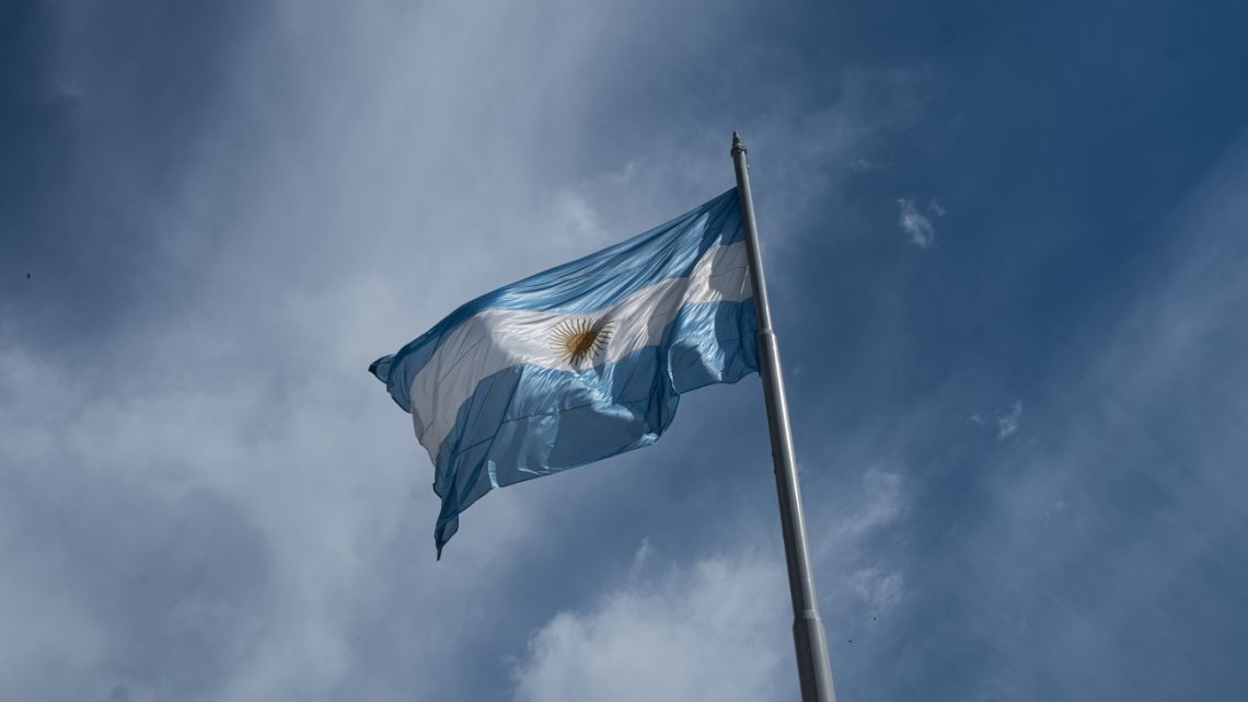 The national flag flies outside the Casa Rosada.