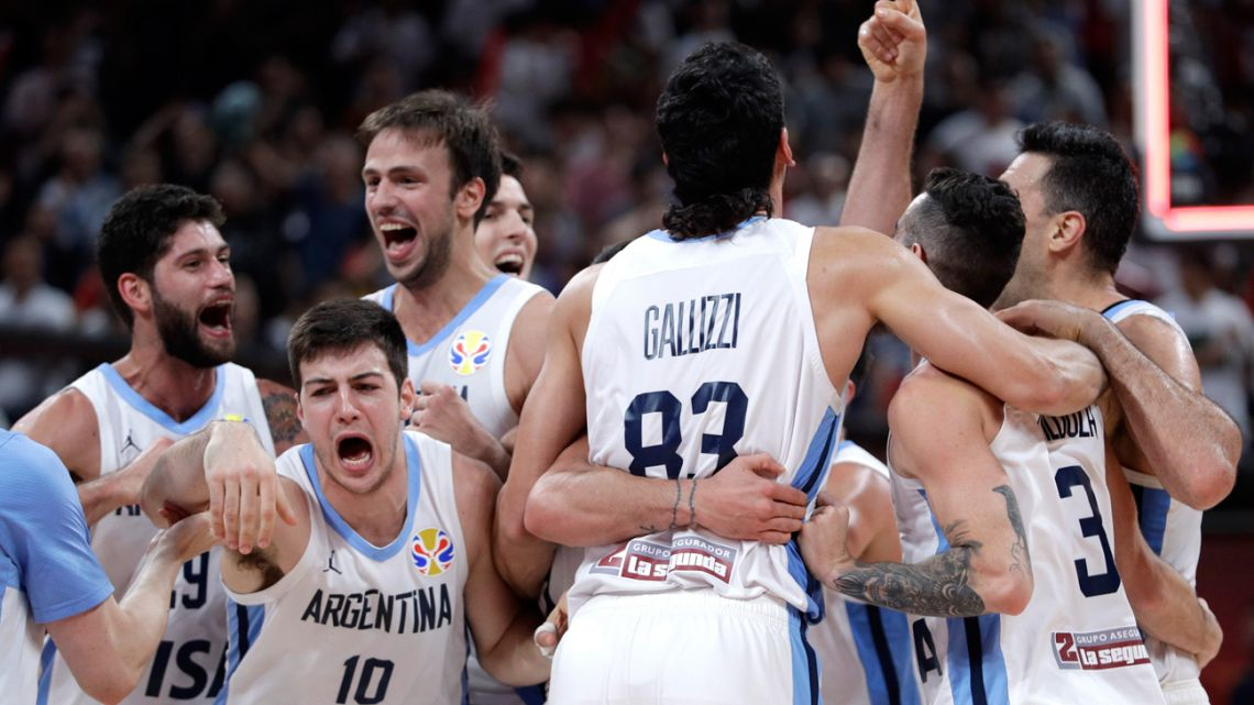Members of Argentina's team celebrate after beating France in their semi-final match against in the FIBA Basketball World Cup at the Cadillac Arena in Beijing, Friday, September 13, 2019.