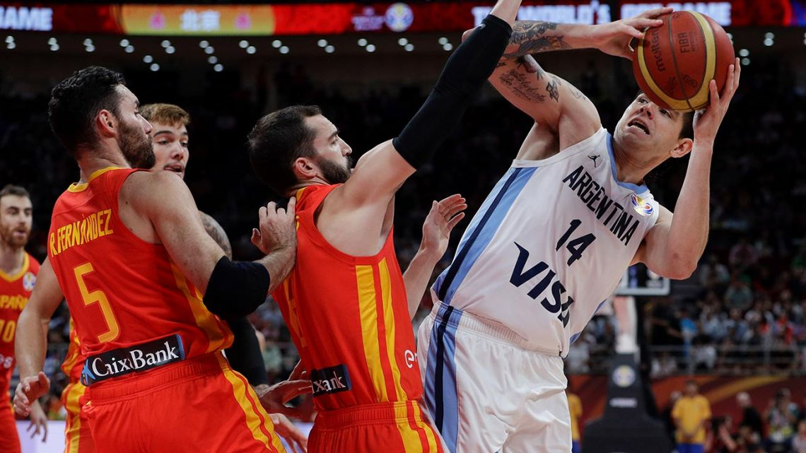 Gabriel Deck of Argentina tries to get past Pau Ribas and Rudy Fernandez of Spain during their FIBA Basketball World Cup Final, at the Cadillac Arena in Beijing, Sunday, Sept. 15, 2019.