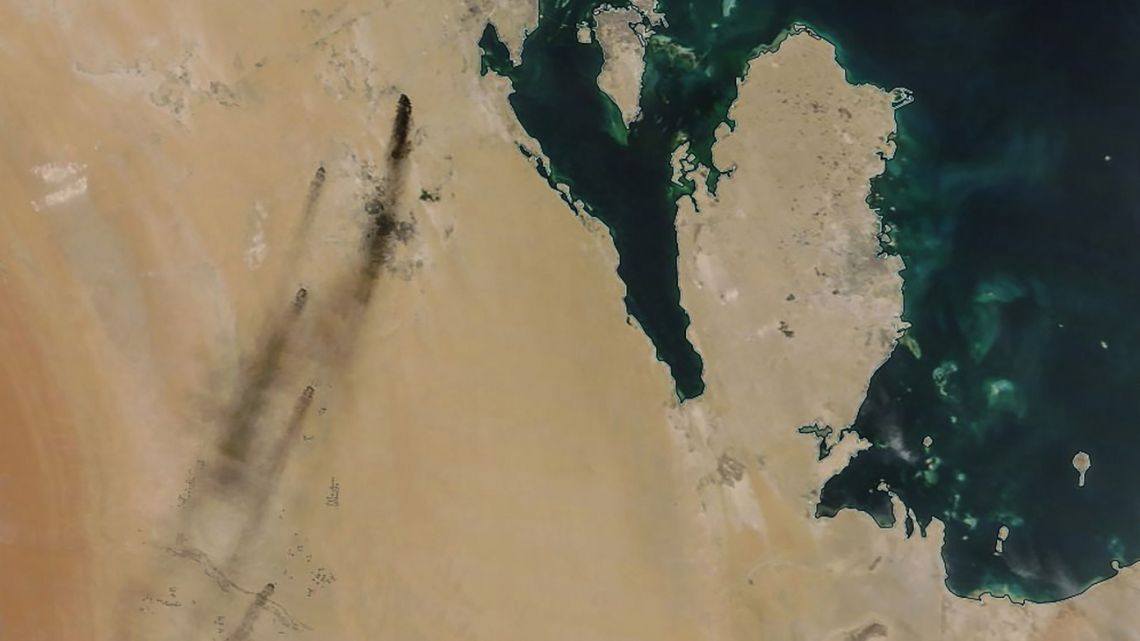 A satellite image provided by NASA Worldview on September 14, 2019, shows fires following drone strikes on two major oil installation owned by the state giant Aramco, in eastern Saudi Arabia, and claimed by the Tehran-backed Huthi rebels in neighbouring Yemen, where a Saudi-led coalition is bogged down in a five-year war. Saudi Arabia raced on September 15, 2019 to restart operations at oil plants hit by drone attacks which slashed its production by half, as Iran dismissed US claims it was behind the assault. The peninsula in the image is Qatar and the island (top) is Bahrain.