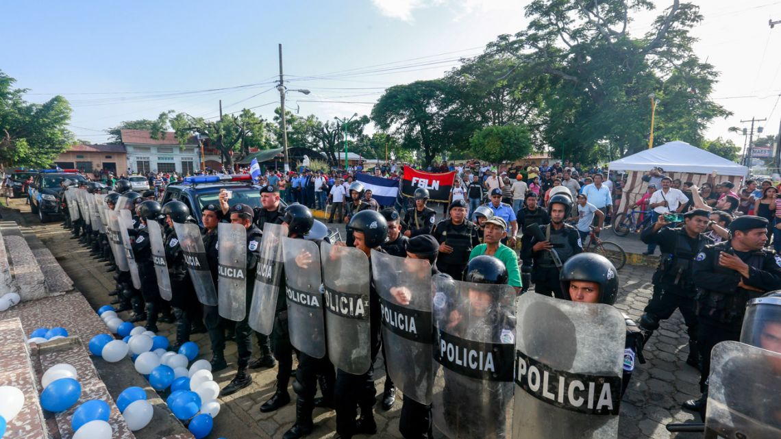 Police form a cordon outside the church in Masaya, Nicaragua, where a Mass is celebrated with a call for the release and freedom of political prisoners.