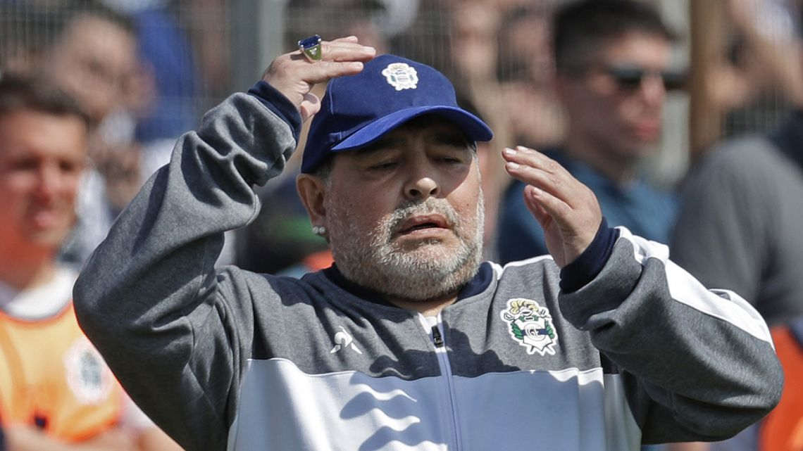 Diego Maradona watches on during the Superliga clash between Gimnasia and Racing Club at the El Bosque stadium, in La Plata.