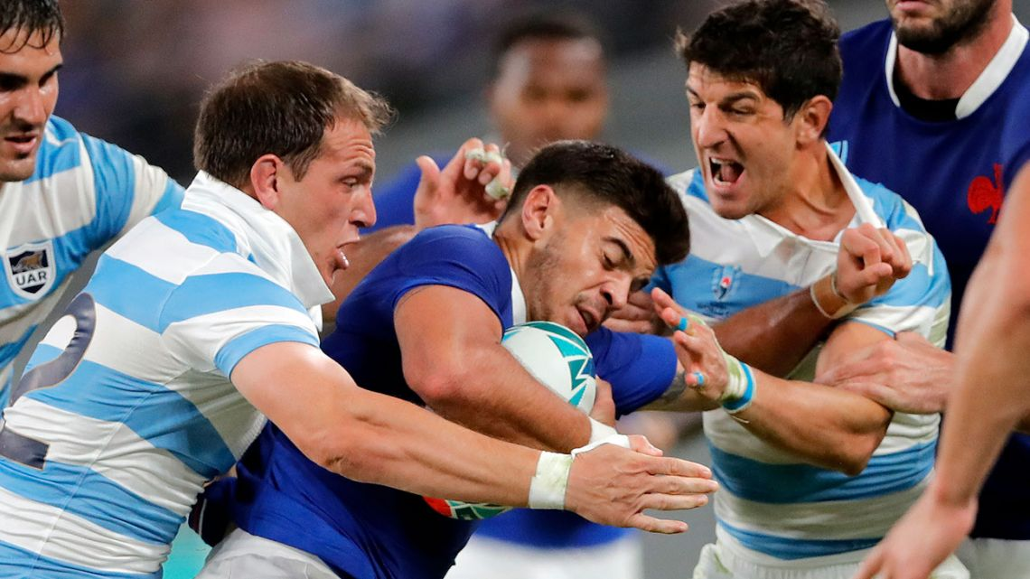 France's Romain Ntamack is tackled by Argentina players during the Rugby World Cup Pool C game at Tokyo Stadium between France and Argentina in Tokyo, Japan, Saturday, Sept. 21, 2019.