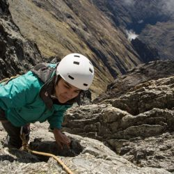 Scientist Cherry Andrea Rojas scales rocks during an expedition to the Humbolt glacier, in Merida, Venezuela