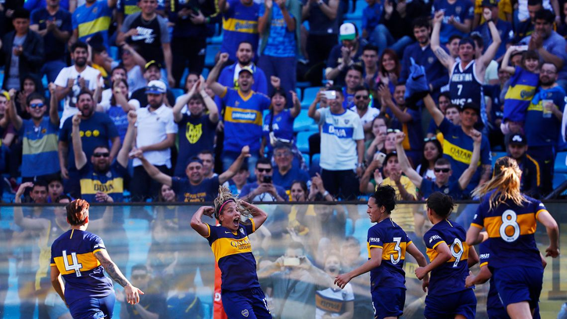 Boca Juniors' Fanny Rodríguez, second left, celebrates with teammates after she scored her team's second goal against River Plate.