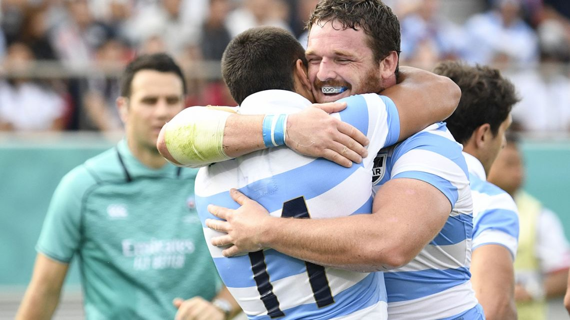 Pumas wing Santiago Carreras (left) celebrates scoring a try with hooker Julián Montoya during the Japan 2019 Rugby World Cup Pool C match between Argentina and Tonga at the Hanazono Rugby Stadium in Higashiosaka on September 28, 2019.