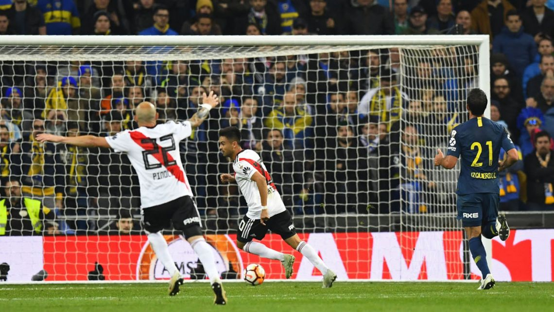 Pity Martínez slots home River's final goal in last year's Copa Libertadores second-leg final clash in Madrid.