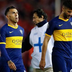 Boca Juniors' Carlos Tevez and teammate Lisandro López leave the field after the loss to River Plate.