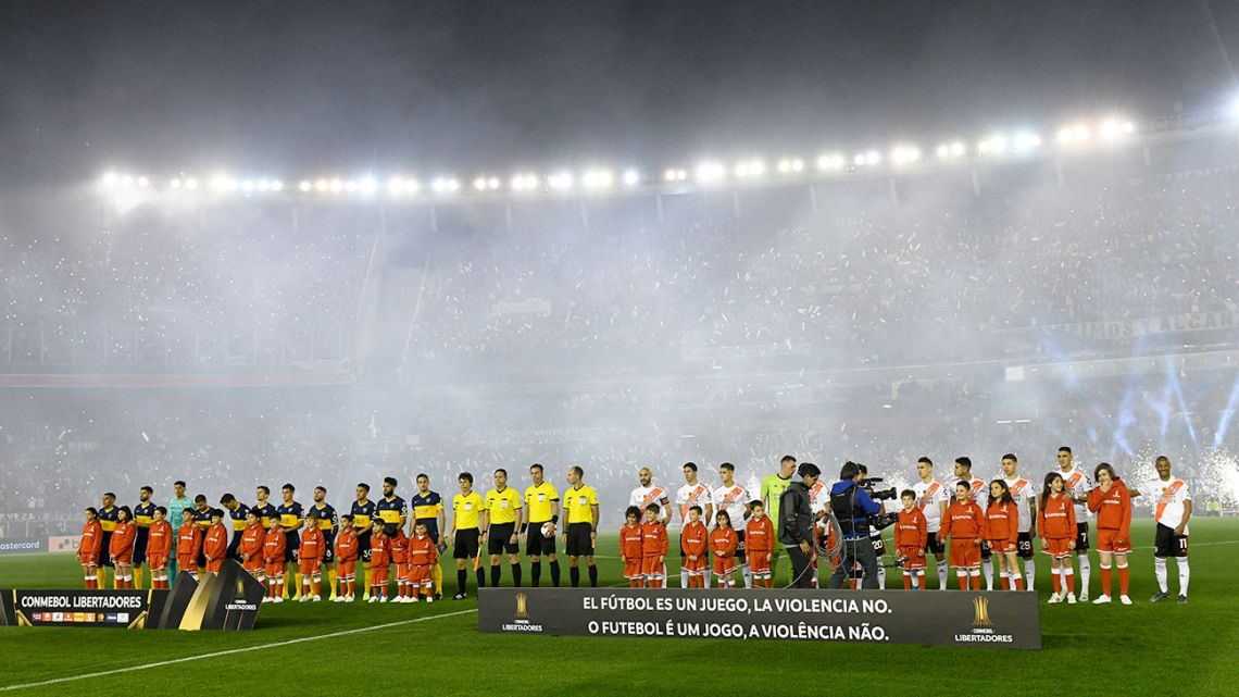 Players from Boca Juniors and River Plate line up prior to their Copa Libertadores semi-final first leg.