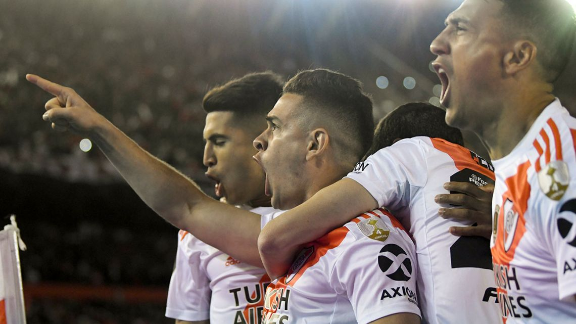 Rafael Santos Borré of River Plate celebrates scoring his side's first goal against Boca Juniors during the Copa Libertadores semi-final first leg at the Monumental in Buenos Aires on Tuesday, October 1, 2019.