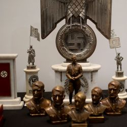 Argentine authorities found the cache of Nazi artifacts in a secret room behind a bookcase, and said that they had uncovered the collection in the course of a wider investigation into artwork of suspicious origin found at a gallery in Buenos Aires.