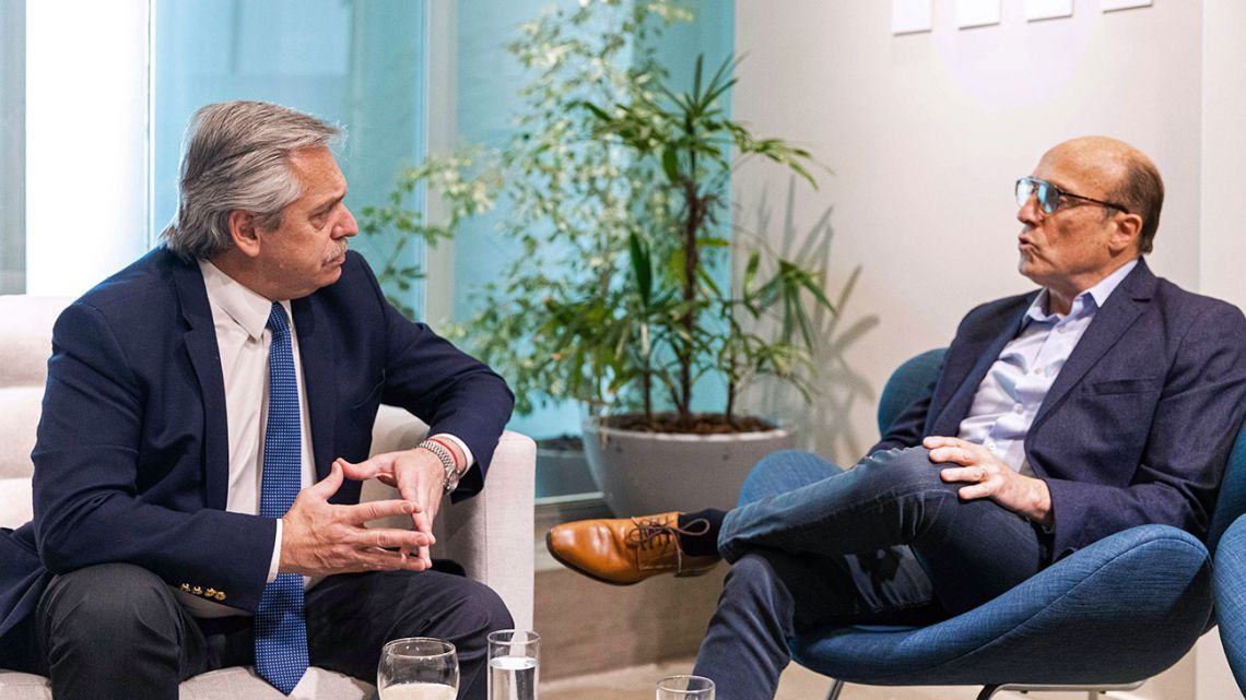 Handout picture released by Frente de Todos shows presidential candidate Alberto Fernández (left) holding a meeting with the presidential candidate for Uruguay's ruling party Frente Amplio coalition, Daniel Martínez, in Buenos Aires on October 7, 2019.