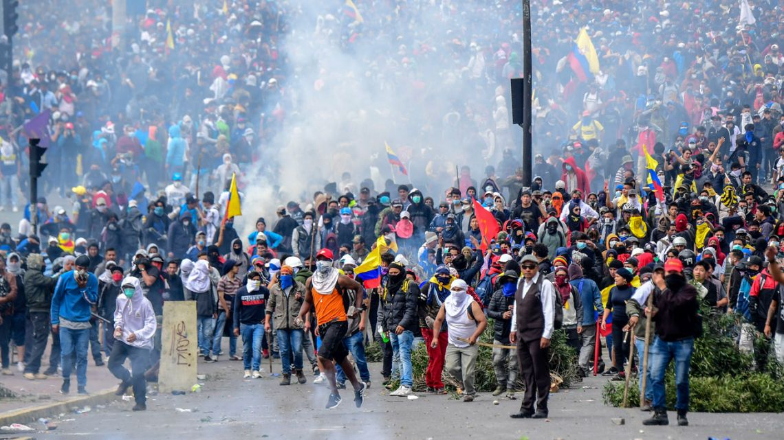 Demonstrators clash with riot police near the National Assembly in Quito on October 8, 2019.