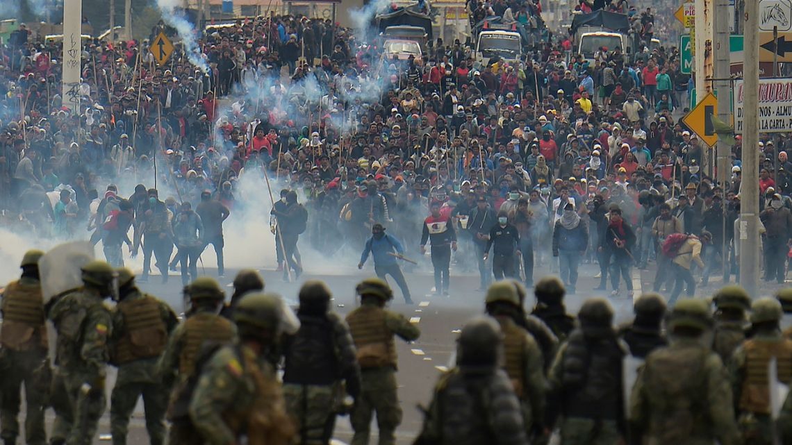 Demonstrators clash with riot police in Quito on October 7, 2019 following days of protests against the sharp rise in fuel prices sparked by authorities' decision to scrap subsidies.